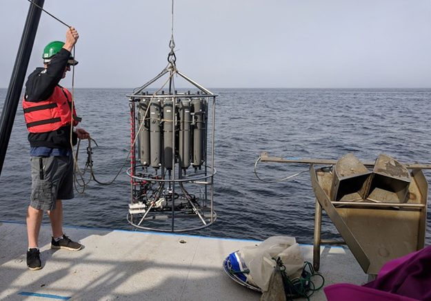 The rosette holds Niskin bottles that collect water at different depths and help measure conductivity (salinity), temperature, and pressure.