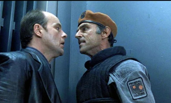 "In this prescient scene from ""Total Recall,"" Everett (Marc Alaimo) explains to Richter (Michael Ironside) the relationship between global warming, crop production, and global food security: ""They're all connected!"""